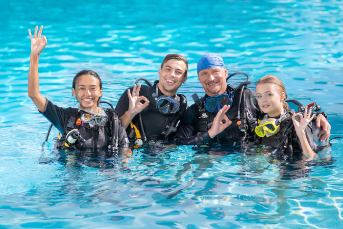 Diver students training in a pool